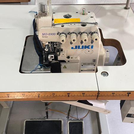 Macchina per cucire e ricamare industriale usata Juki MO 6900